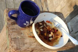 Dried fruit and pancake for breakfast with a coffee.